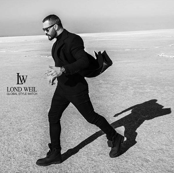 میلاد کی مرام با کت و شلوار رسمی در کویر + عکس