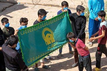 پرچم متبرک گنبد حرم امام رضا در مراسم چهارپایه خوانی