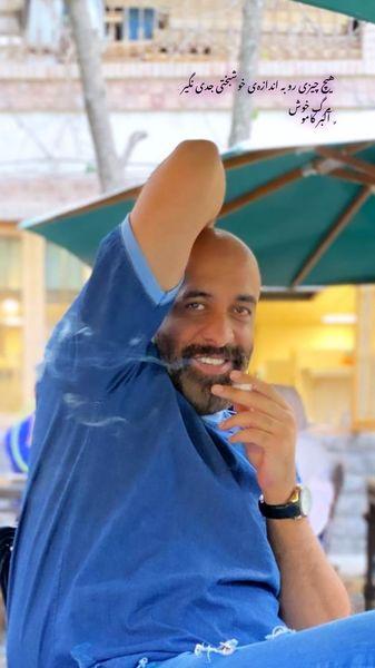 سیگار کشیدن پیام احمدی نیا در یک کافه + عکس