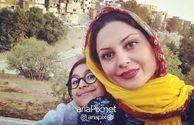 تم نارنجی سولماز غنی در این عکس